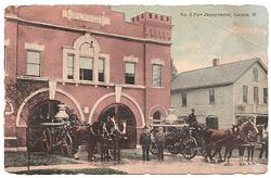POstcard depicting fire brigade leaving fire house in carriages